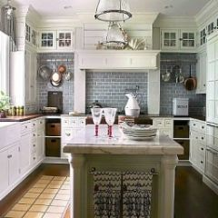 Another gray tile white cabinets combo but also butcher block and carrera marble. Gorgeous!