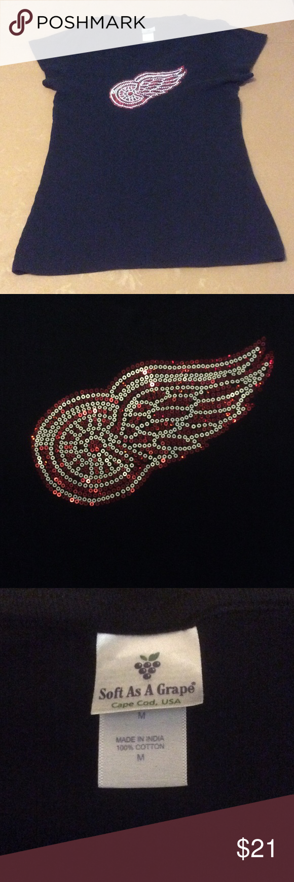 NHL Detroit Red Wings Hockey bling t-shirt EUC Great fan wear!  Very soft, black v-neck tee with the Detroit Red Wings logo blinged in sequins.  Looks lovely, ready for the game!  100% cotton  Size Medium Soft As A Grape Tops Tees - Short Sleeve