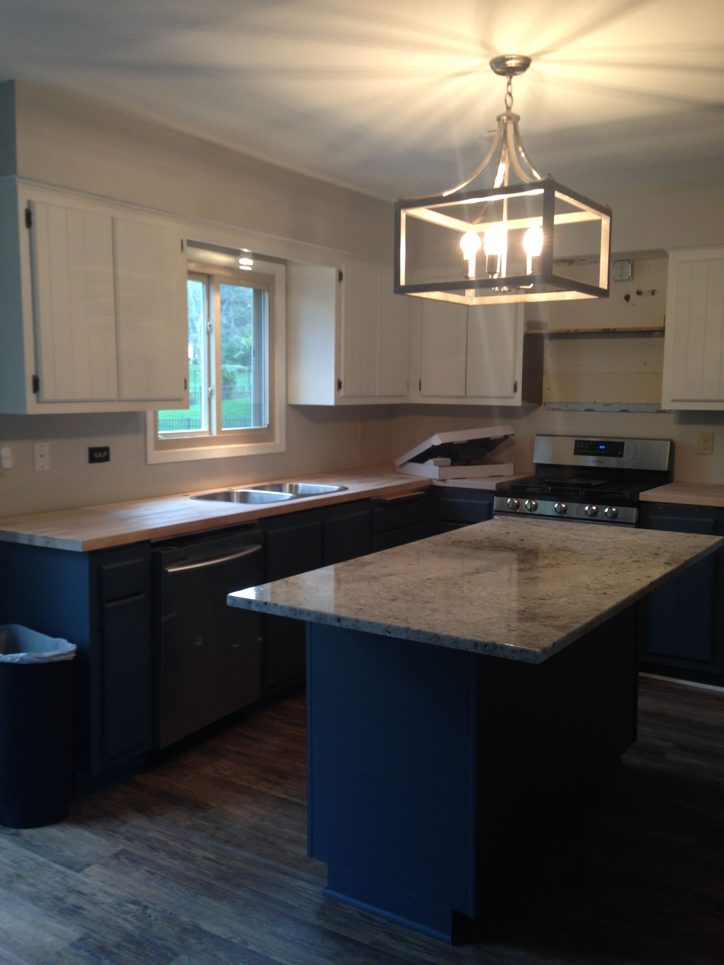 Remodeled 1970s kitchen mid-way. Granite on island ...