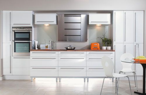 Don't just think about eye level and ceiling lighting - putting hidden lighting beneath units will help break up a straight run and give the room depth.