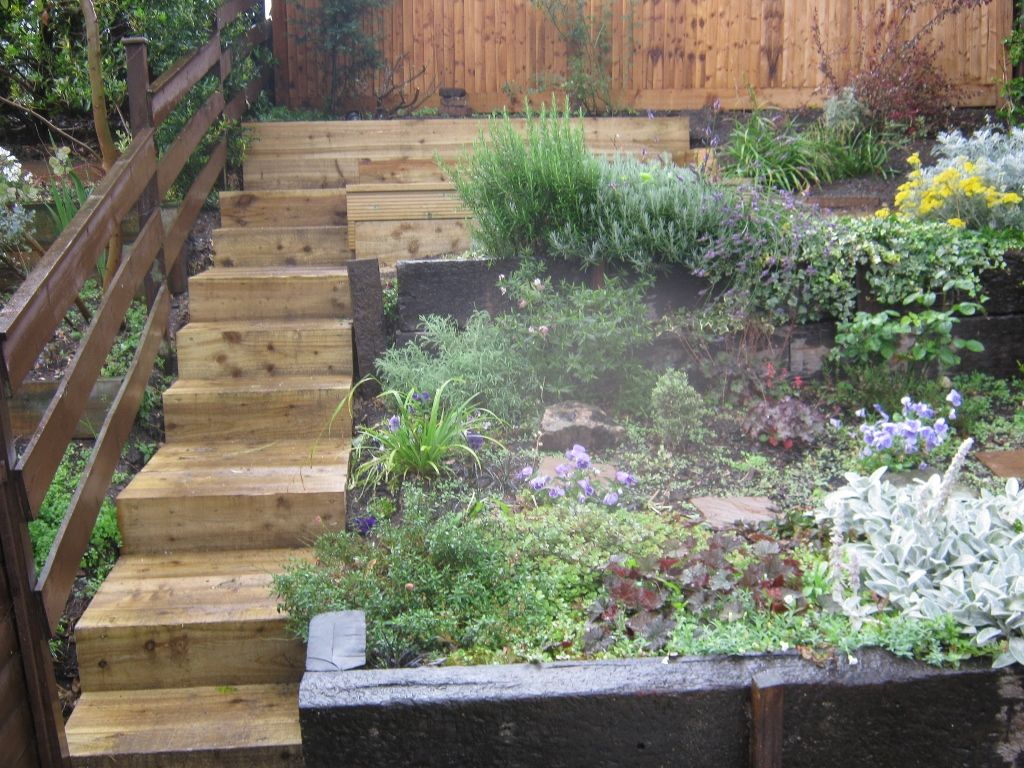 fantastic landscaping with railway sleepers for a small ...