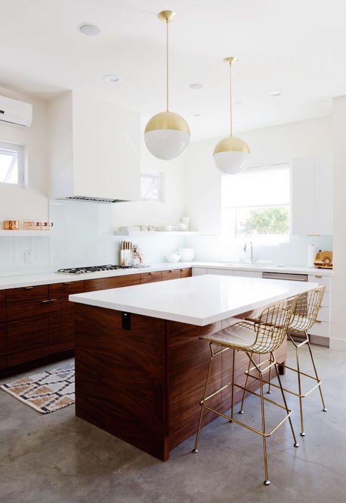 Beautiful white and walnut kitchen with brass accents   mid century
