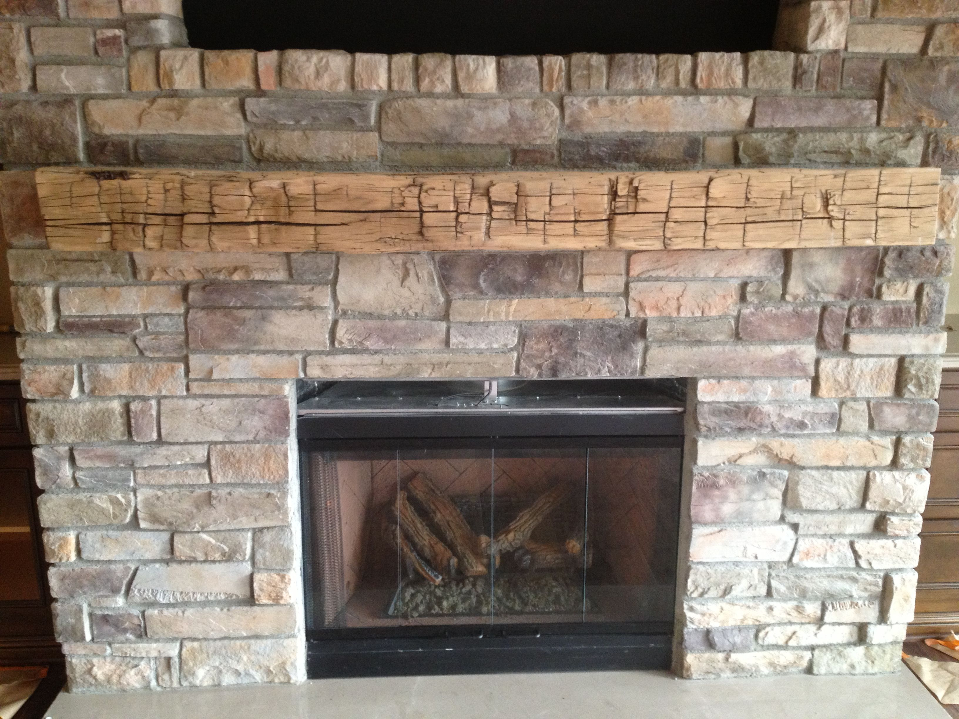 Old World Reclaimed Wood As A Fireplace Mantel Hand Hewn Beams