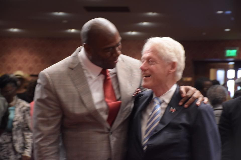 President Bill Clinton and Earvin