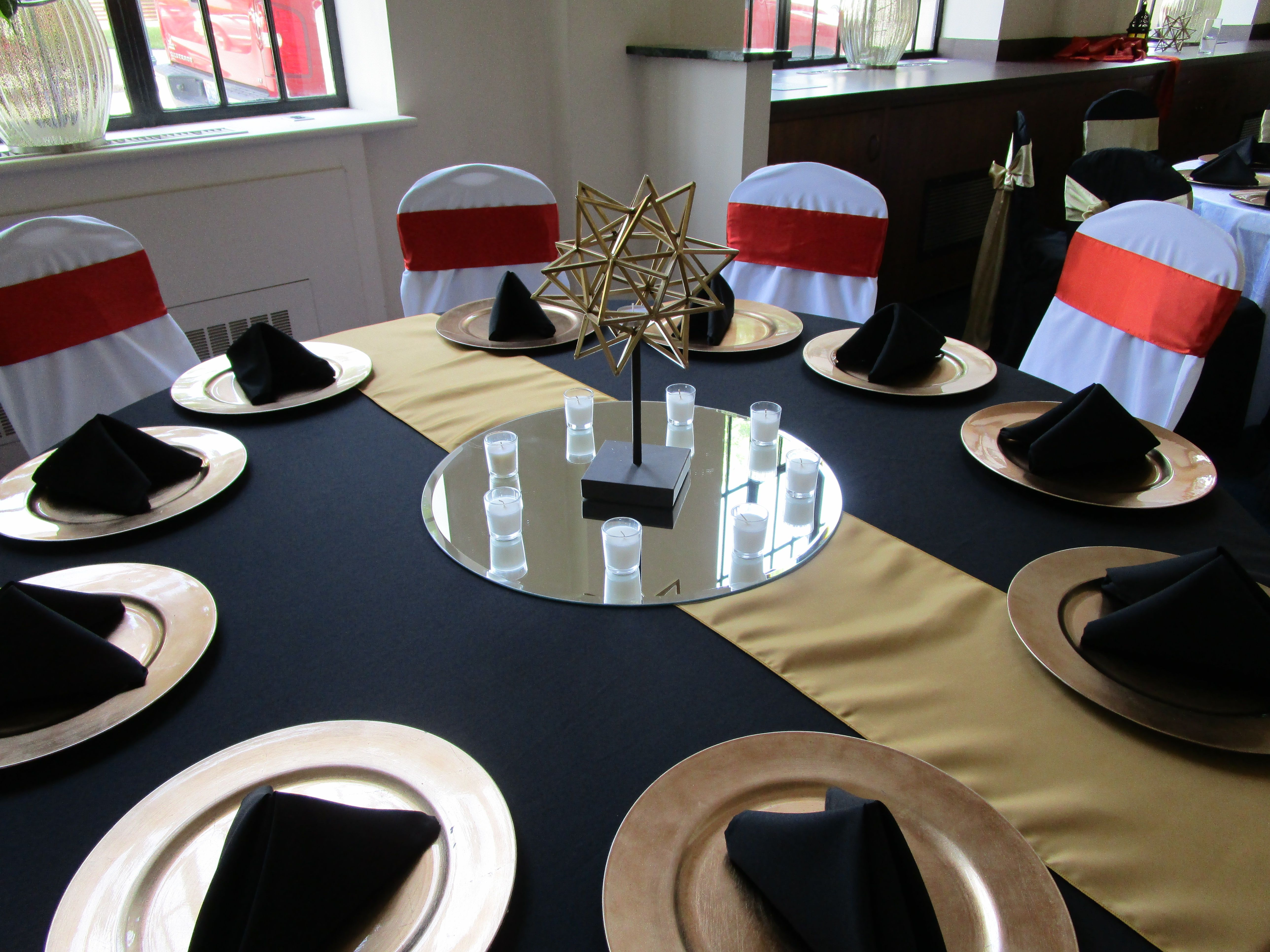 Black Tablecloth And Napkins, Gold Runner And Chargers, White Chair
