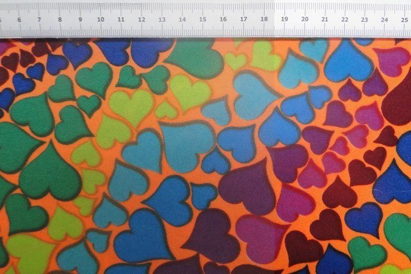Texture stof, Oranje met gekleurde hartjes-bbms.nl - Bas Bastiaans