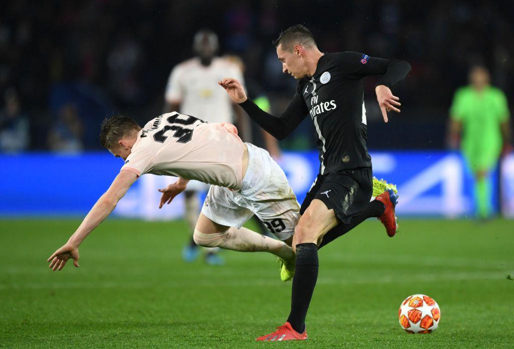 PARIS, FRANCE - MARCH 06: Julian Draxler of PSG tackles Scott ...