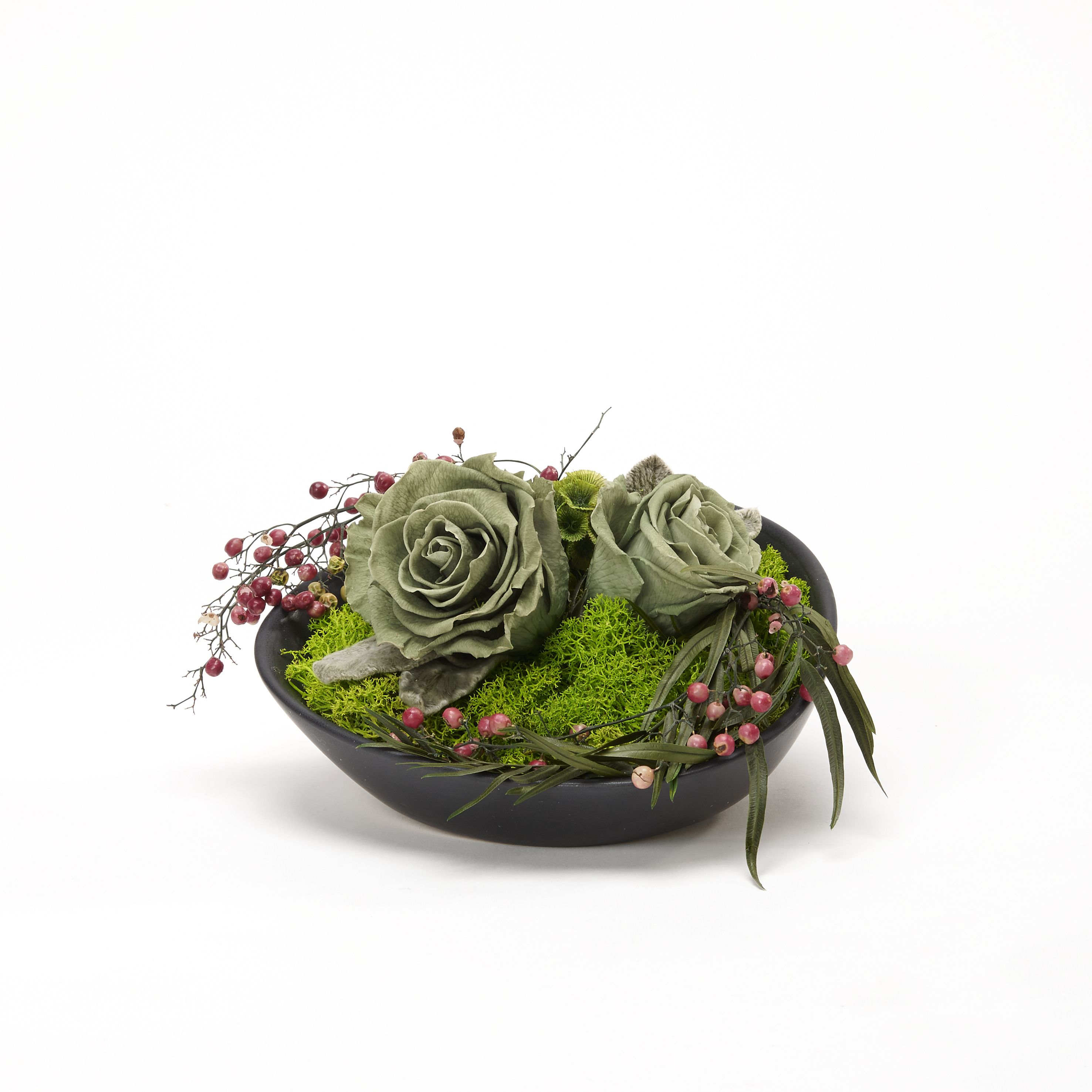 Green moss with pepper and two green tea roses. The perfect color match!