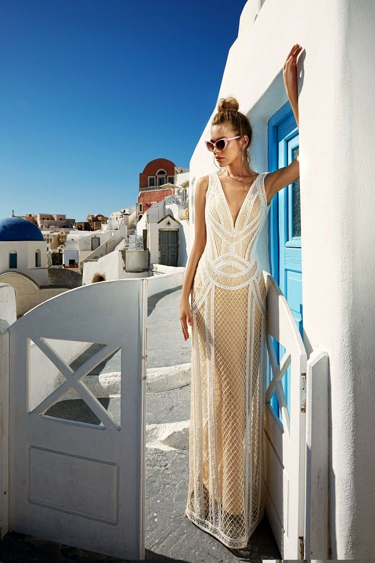 Sleeveless deep v neckline embellishment sheath wedding gown #weddingdress #weddinggown #weddings