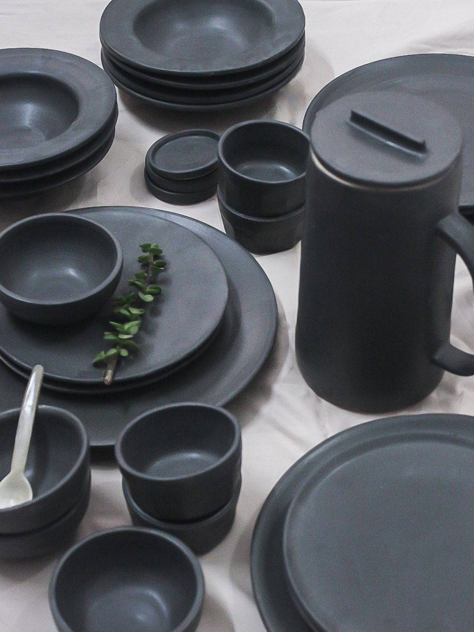Minimal handmade black stoneware ceramic dinner plates and bowls