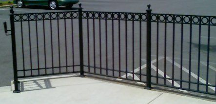 Rod iron banisters commercial wrought iron railing with ring design diy remodel in 2019 for Wrought iron balcony railings exterior