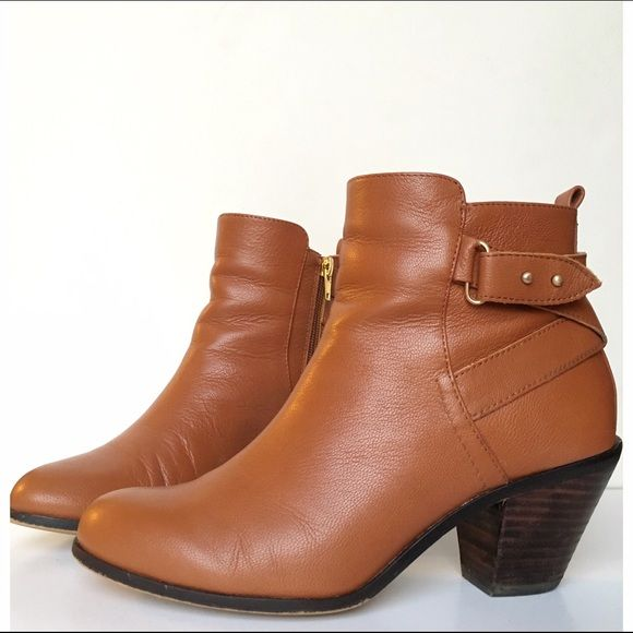 """Sole Society """"Idelle"""" Booties just-right stacked heel lifts a downtown-cool bootie detailed with crisscrossed leather straps. 2 1/2"""" heel (size 8.5). 4 1/4"""" boot shaft. Side zip closure. Leather upper/synthetic lining and sole. By Julianne Hough for Sole Society; imported.   Note: Boots have a small knick on the front and a little scuffing on the back. Sole Society Shoes Ankle Boots & Booties"""