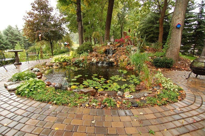 Paver patio surrounds water garden pond minnesota for Garden pool surrounds