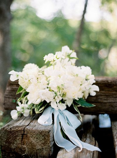 Soft and pretty white bouquet with pale blue ribbons
