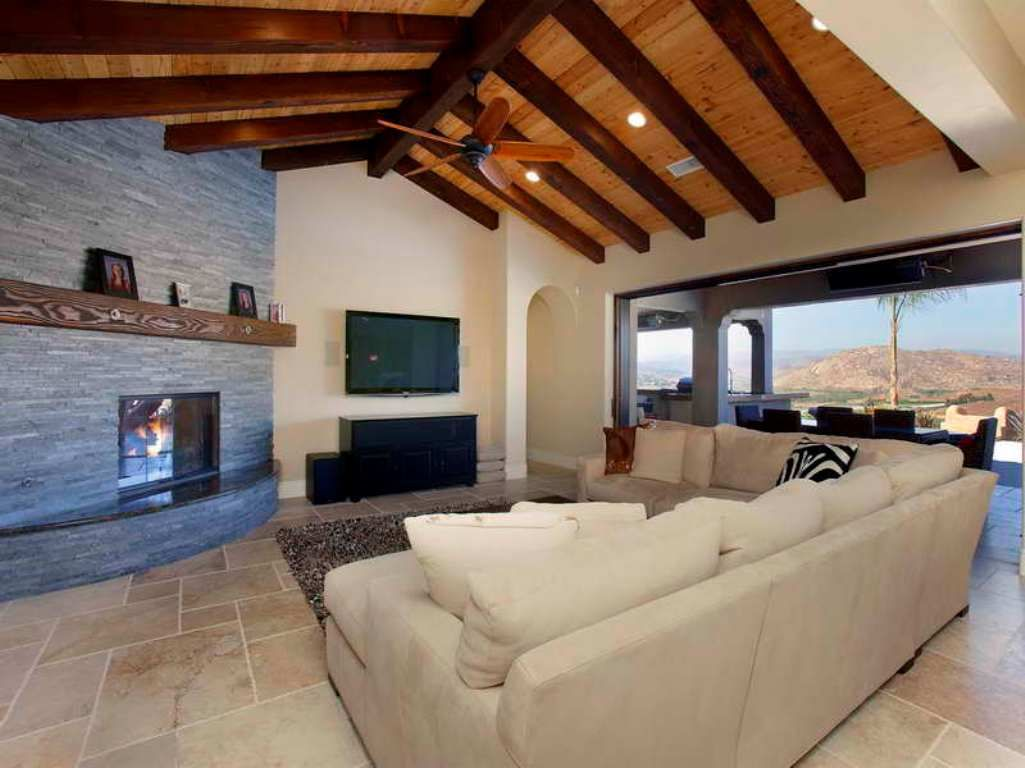Open Ceiling Living Room With Exposed Beams