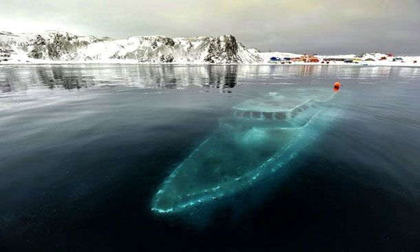 Magical & Mysterious Abandoned Places In The World - Sunken & frozen yacht in Antarctica
