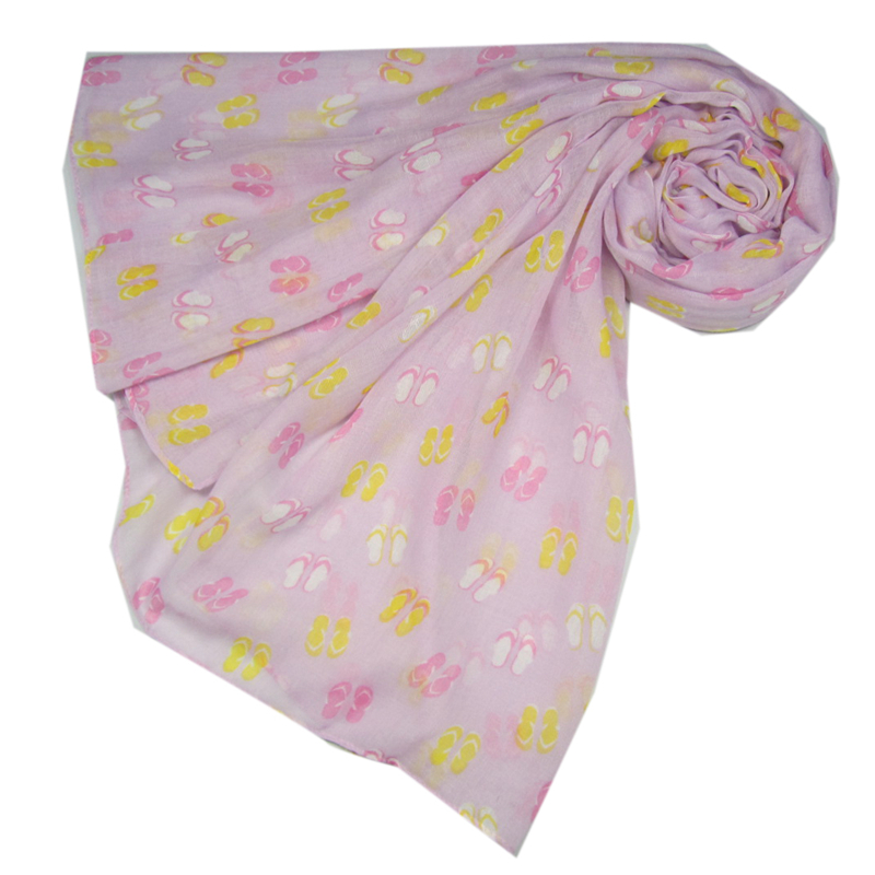 This is the perfect scarf to see you into summer! Colourful flip flops are scattered throughout this pink coloured scarf. A great casual scarf for all ages making it a great gift for a friend...or yourself!  It's super soft and large enough to wear as a wrap and also makes a great sarong. It's a generous size but lightweight and very comfortable.  All scarves come wrapped in pretty pink tissue. Approx. size is 180cm x 90cm.
