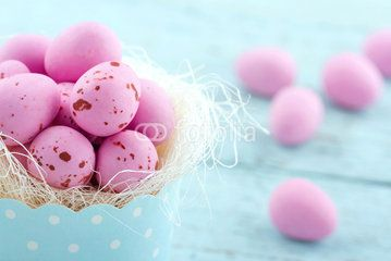 Pink easter eggs in a blue cupcake cup