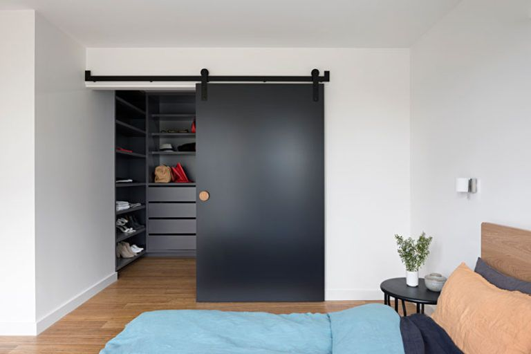 A Contemporary Update For A 1970s Brick House In Melbourne In 2020 Melbourne House Interior Barn Doors Brown Brick Houses