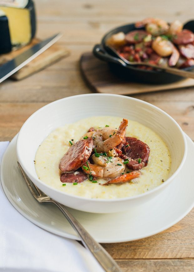 Shrimp and Smoked Sausage with Aged Cheddar Grits | www.kitchenconfidante.com Creamy grits may be simple but they are decadent with aged cheddar cheese, and delicious with each bite of spicy shrimp and smoked sausage!