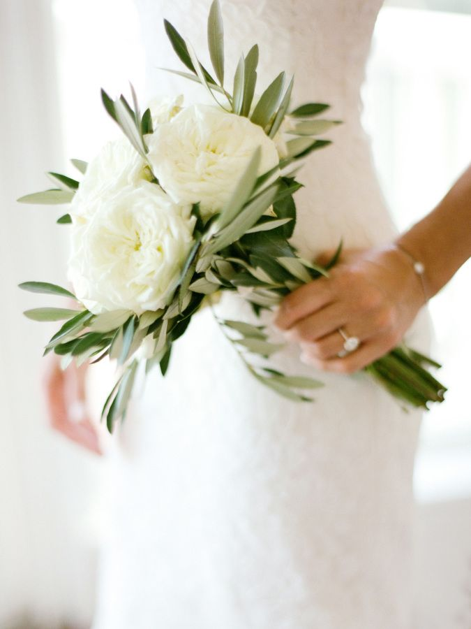 white and greenery minimalist wedding bouquet Nature has never looked so good with these timeless green stems. To achieve a natural look on your wedding day, swap a floral bouquet for one with lots of