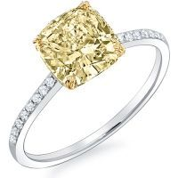 This lovely canary diamond engagement ring features a 1.27 Ct. Fancy Yellow Cushion cut diamond with SI2 clarity. Round cut diamonds (.25 ctw.) are placed down the shank in pave setting. This 1.27 Ct. diamond ring is offered in 14K white or yellow gold, 18K white or yellow gold or platinum.