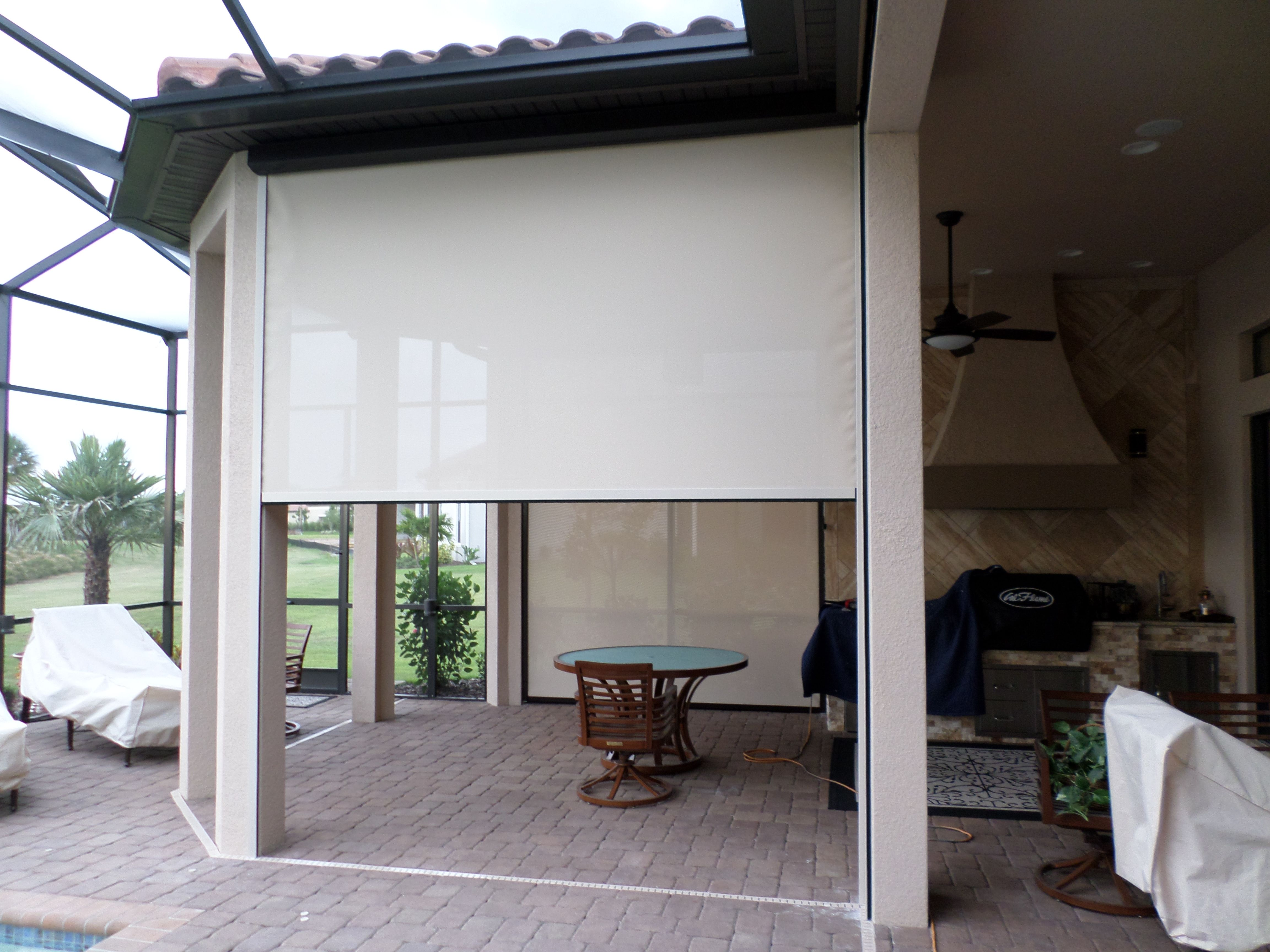 Motorized roll down shade and privacy screen for back ...