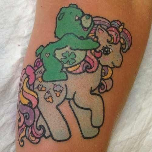 Stacey it is a carebear riding a my little pony tattoo for My little pony tattoo