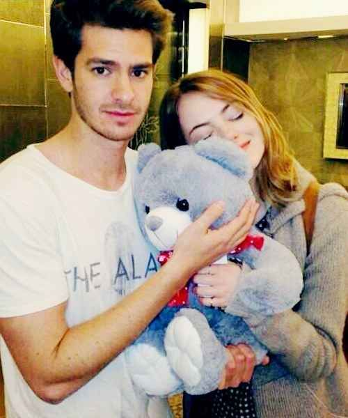 And then when they posed for a fan and cuddled with this stuffed bear: | 26 Times Emma Stone And Andrew Garfield Spread Their Perfection All Over The World
