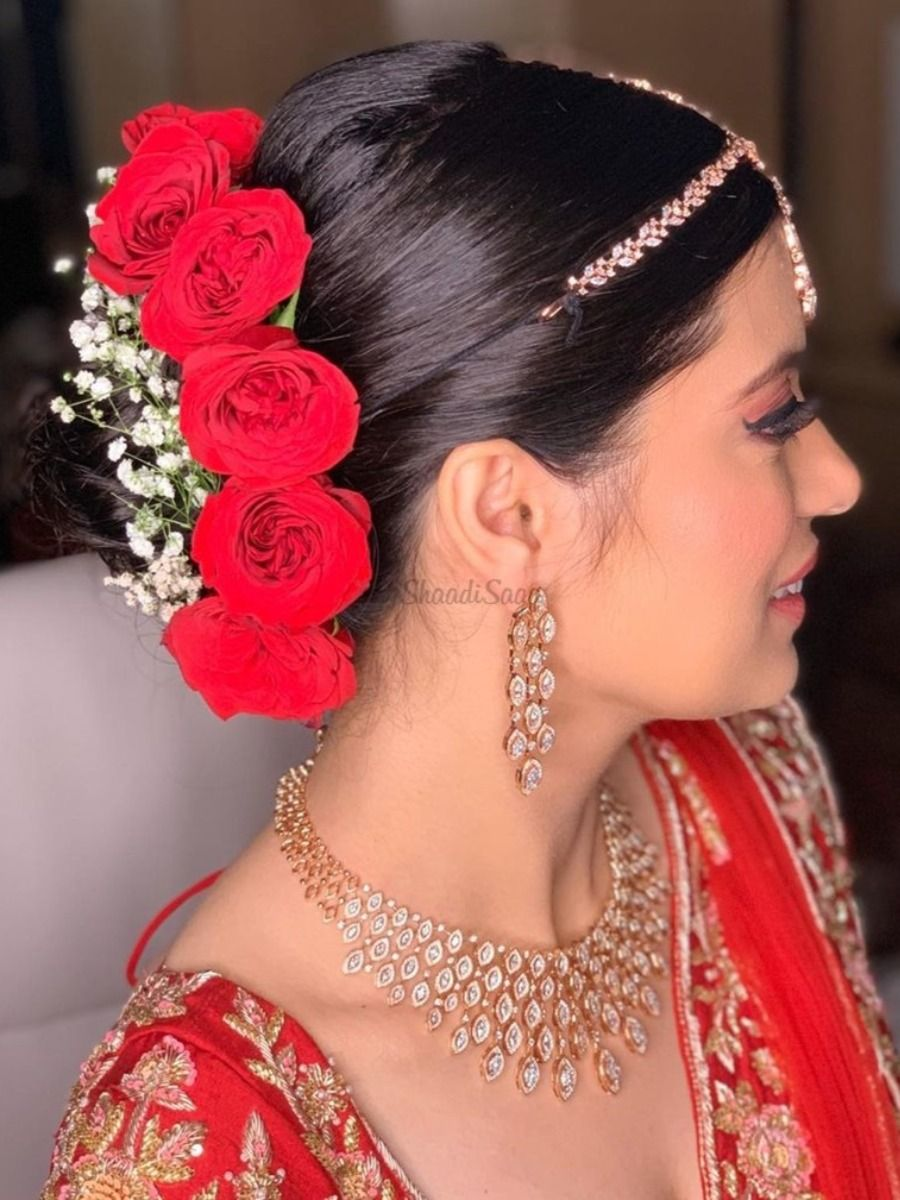 Floral Fiesta 13 Types Of Flowers For Your Bridal Hairstyle Bridal Hair Accessories Indian Bridal Hairstyles Big Bun Hair