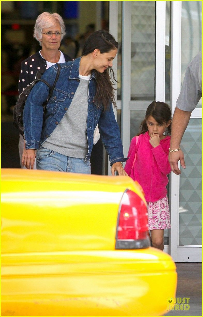 Katie Holmes arrives on a flight at JFK Airport with her daughter Suri on July 2, 2013