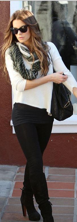 Kate Beckinsale: Sunglasses – Oliver Goldsmith  Purse – Givenchy