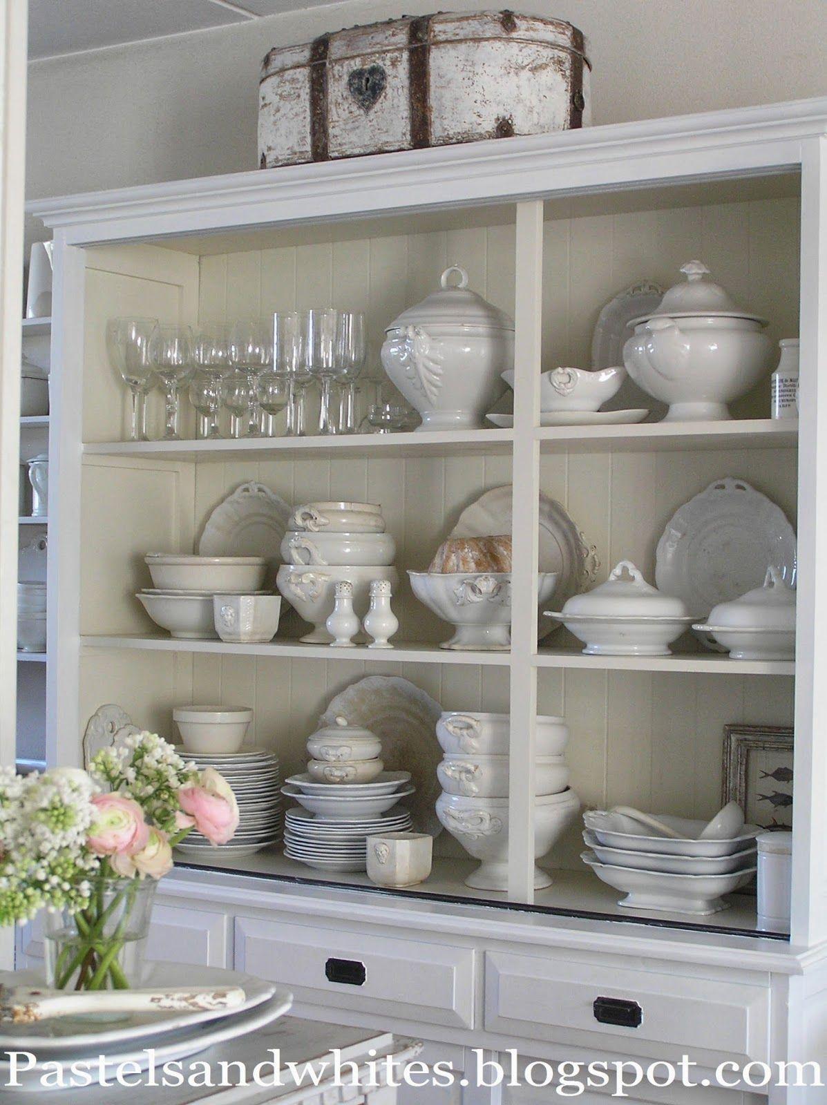 http://pastelsandwhites.blogspot.com/ - beautiful dresser with loads of white crockery