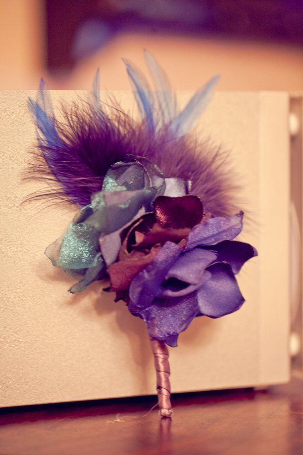 feather and fabric flowers for colorful winter wedding