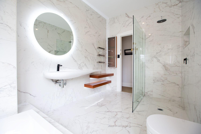 A gorgeous example, using a Calacutta marble look tile | Bathrooms ...