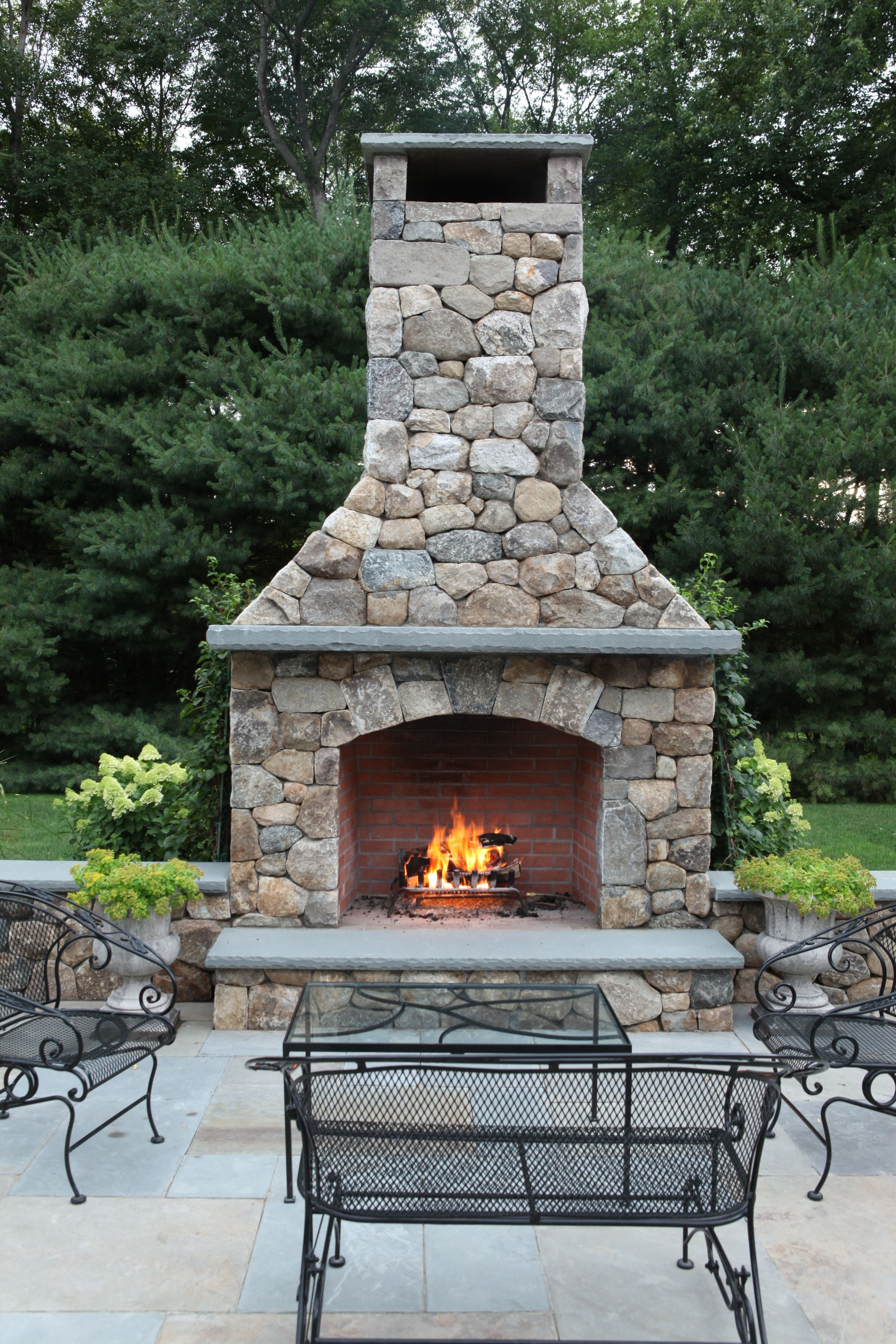 Outdoor fireplace built by freddyus landscape company house