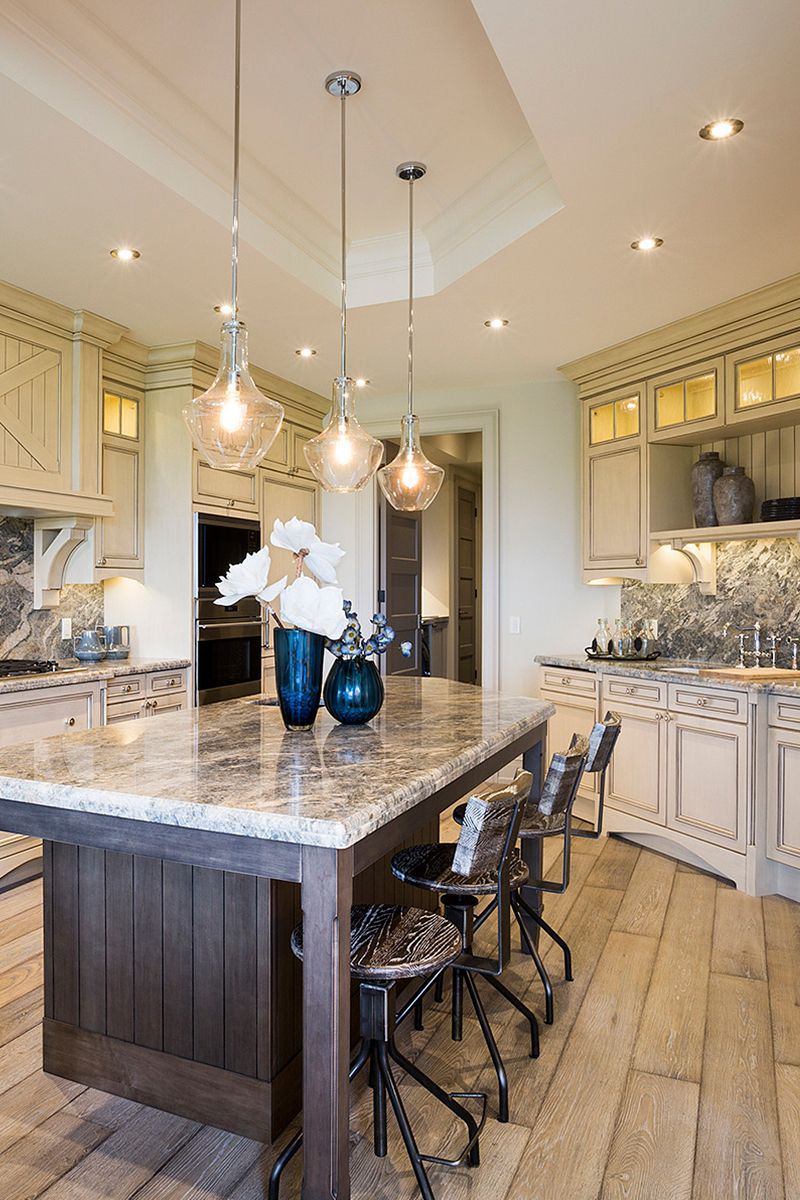 Upscale French Country Elegance With A Stone Topped Island Sleek Gla Dream Kitchen Luxury French Country French Country Light Fixtures French Country Kitchens