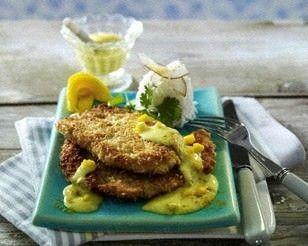 Das Rezept für Putenschnitzel mit Kokospanade, Curry-Mango-Soße und Reis und weitere kostenlose Rezepte auf LECKER.de