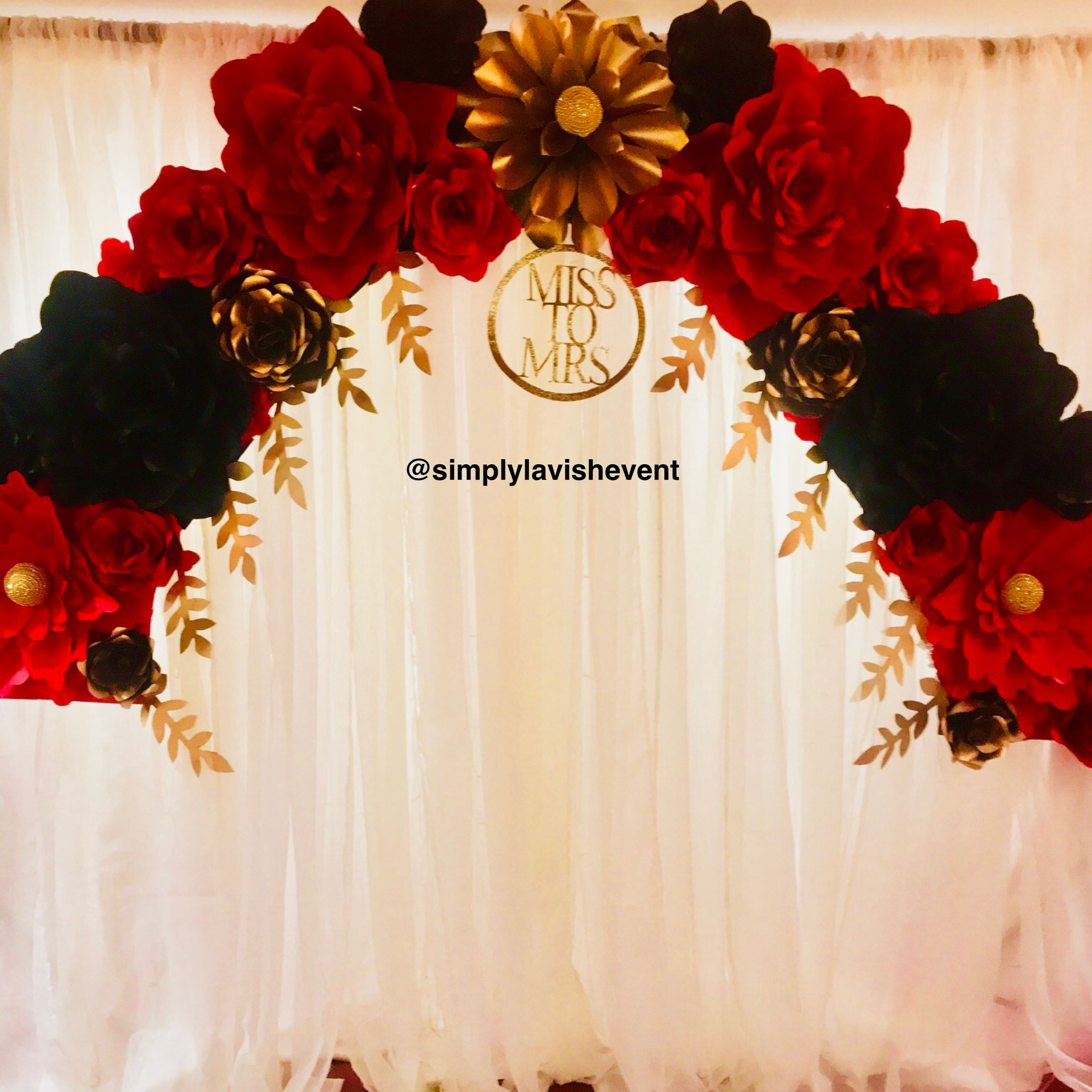 This Stunning Paper Flower Arch With Red Gold And Black Roses Is