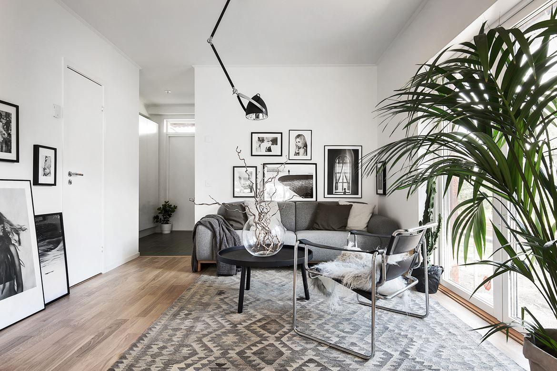 Decoratie Planten Woonkamer : Een scandinavisch appartement met grijstinten én veel planten