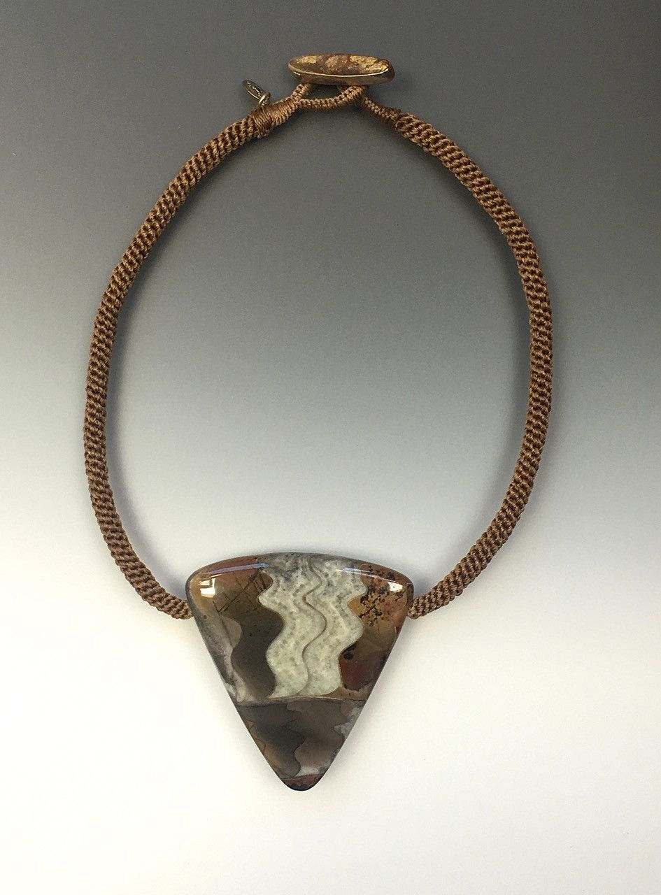 Fossilized ammonite, hand woven cord, jasper toggle button