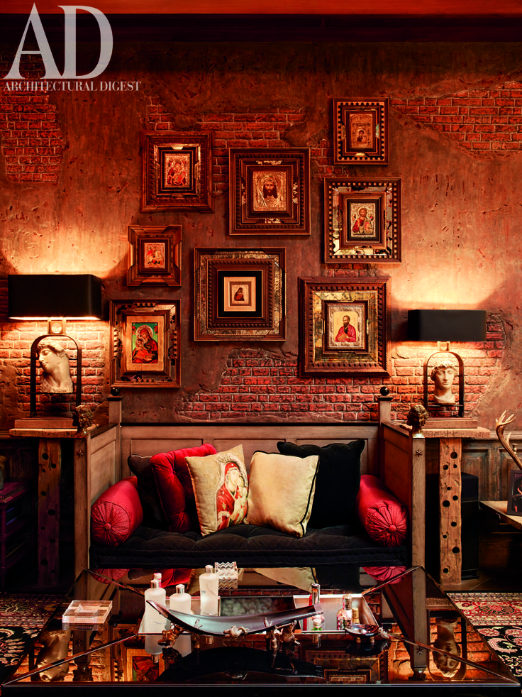 The #living #room of Mannat — Gauri and Shah Rukh Khan's #Mumbai #home. #Rustic, #Faux #brick #wall, #Center #table, #Lamps, #Christian #iconographs. Photographer: Chris Brooks