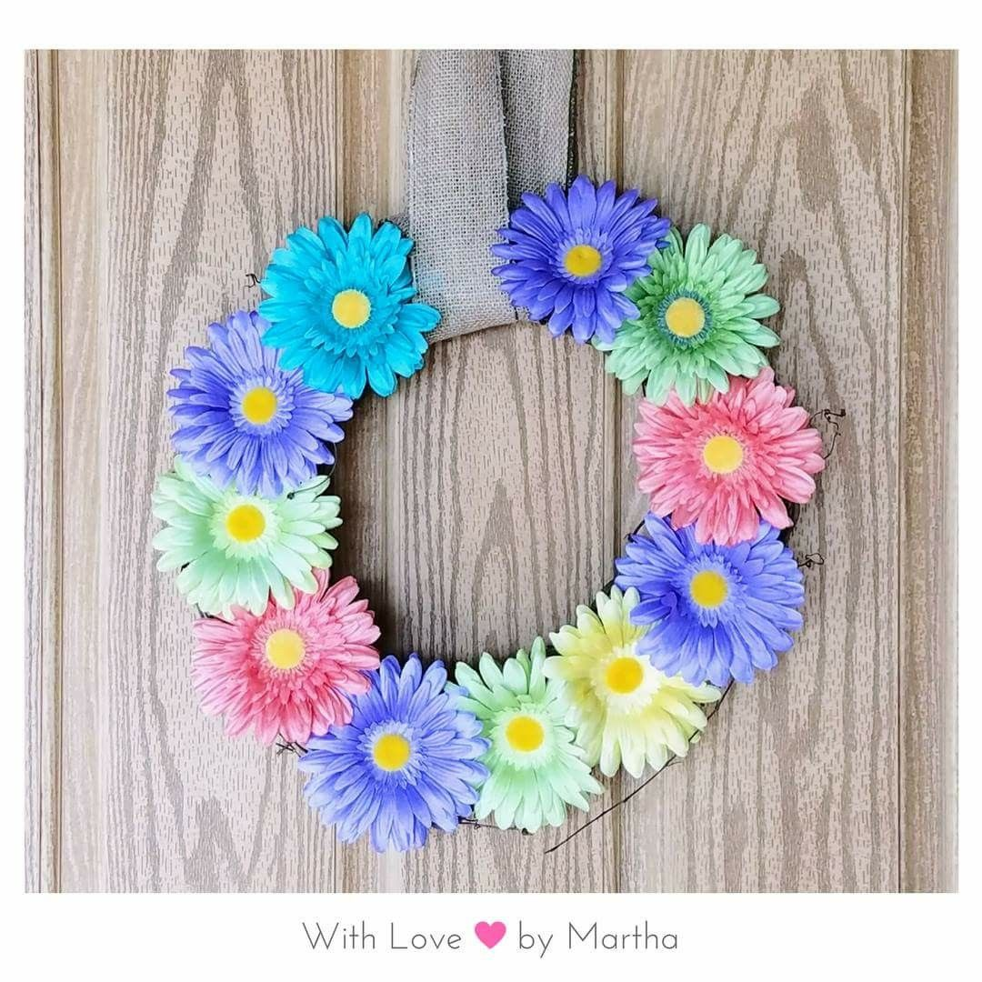 Springtime Wreath-  When you realize you have exactly 11 gerbera daisies just laying around. You put them to good use. I call it, the Leftover Gerbera Daisies Wreath! 14in grapevine wreath. Only $15.00