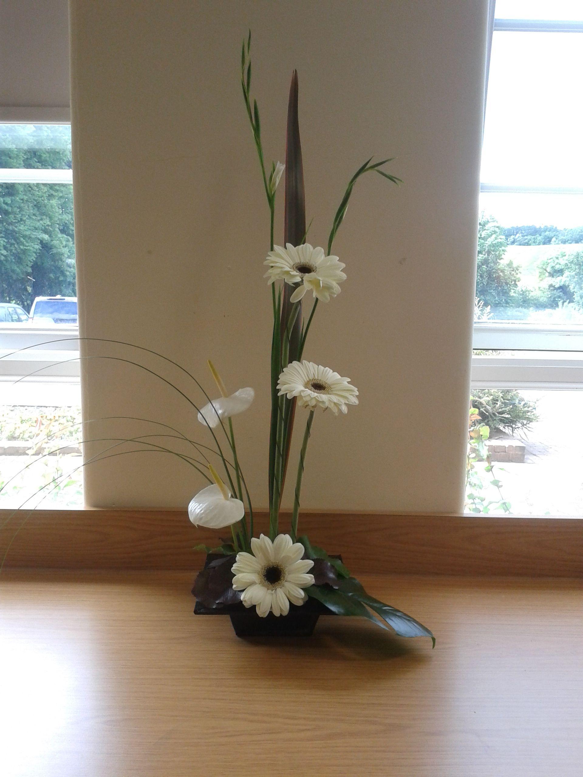 White Gerbera and Anthurium form linear design | Ceremony ...