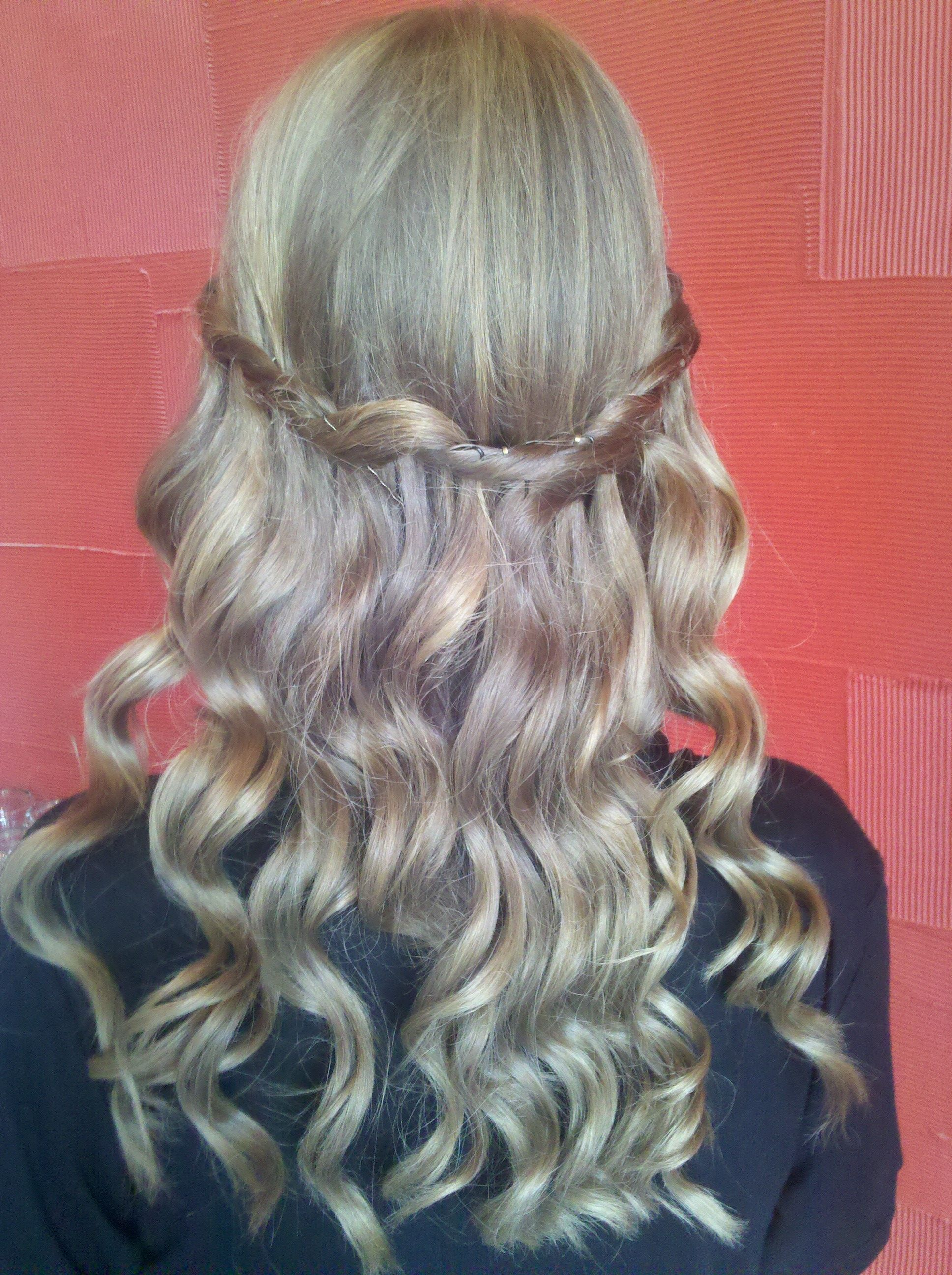 Curls with a braid done by one of our stylists, Jafra