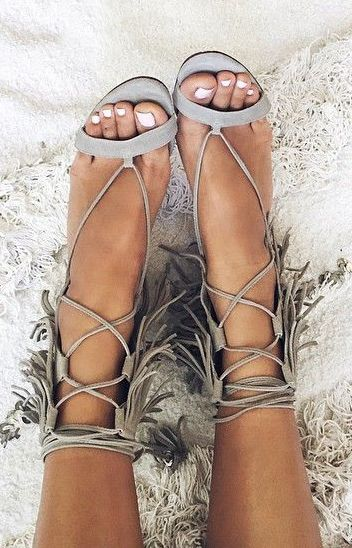 87c0652ed0b0 Suede leather dress fringe ankle sandal featuring a lace up vamp and  towering ankle wrap with three layers of fringe. Pinterest  chloebush412