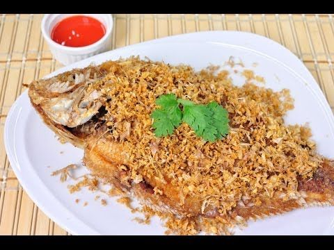 Thai food fried tilapia with garlic pla tub tim tod kra tiam thai food fried tilapia with garlic pla tub tim tod kra tiam this is an easy delicious fish dish big tilapia marinated with garlic pepper forumfinder Image collections