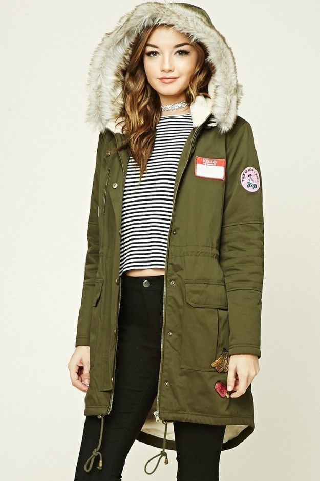 3ae227eecb7 A faux fur hooded parka with a collection of patches that make it look  super lived-in and personalized.
