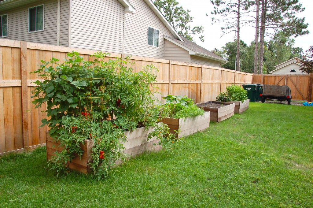 raised garden beds along the side of the fence for a on backyard fence landscaping id=94529