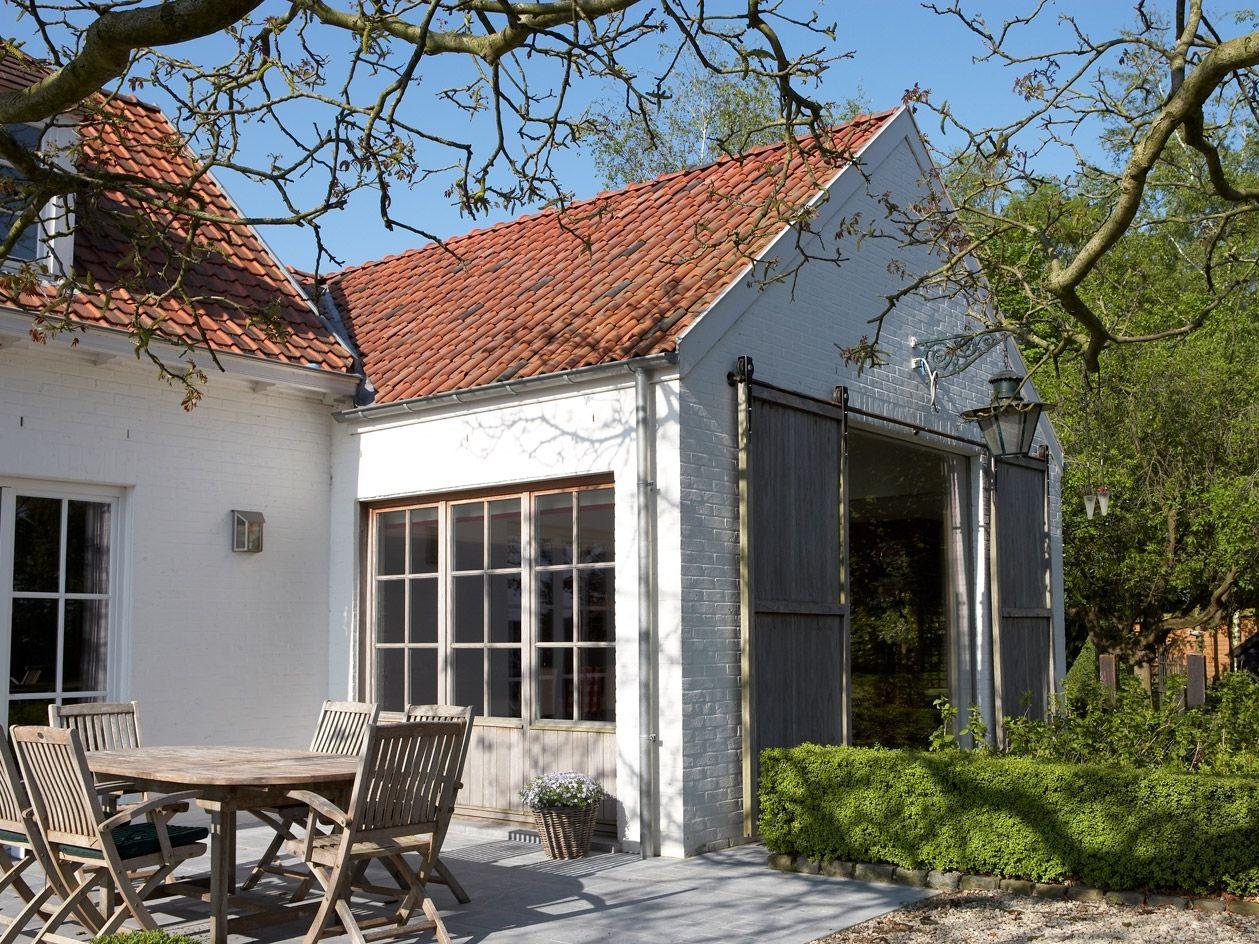 Best Spanish Tile Roof With Cream Brick Exterior Barn Doors 400 x 300